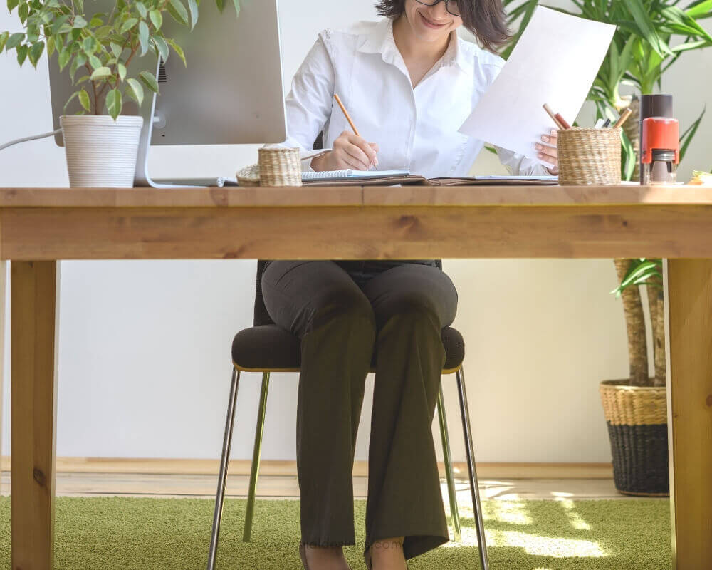 Body Posture when practicing_women sitting on a desk writing Calligraphy