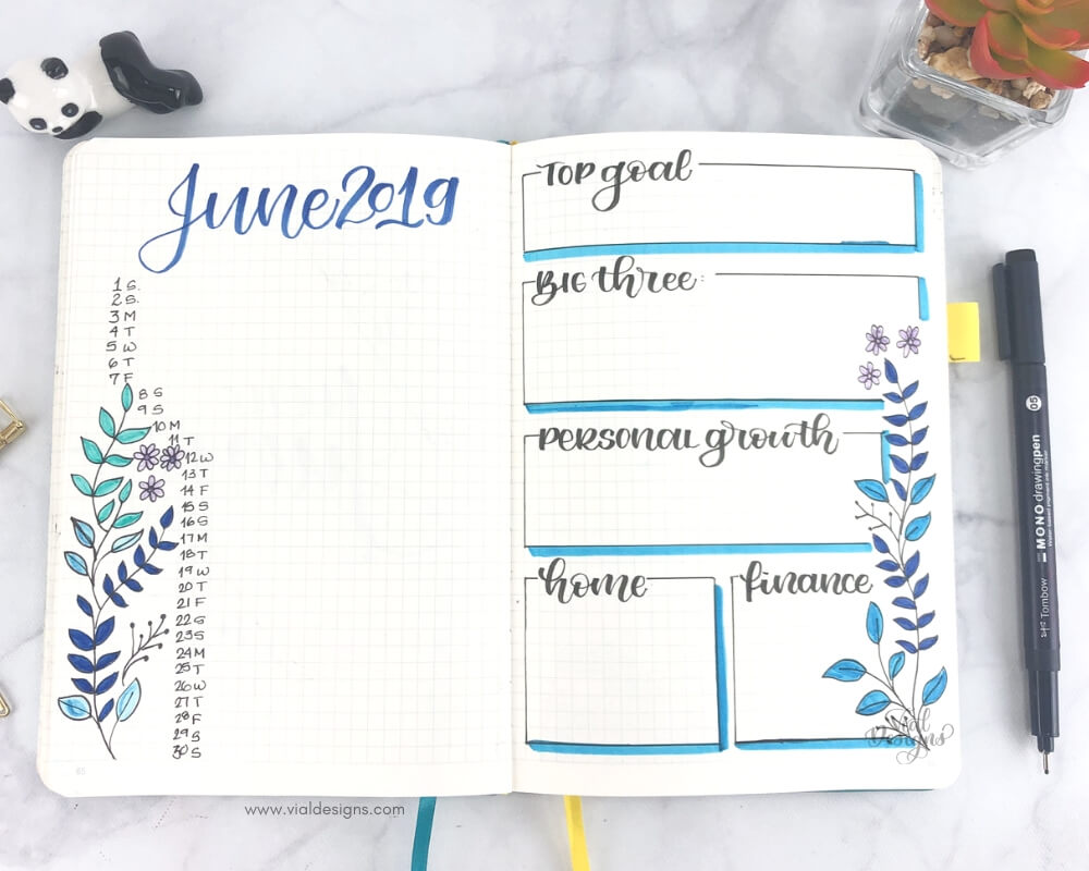 Plan with me June 2019 Bullet Journal Set up showing my Calendar and goal pages with blue floral doodles