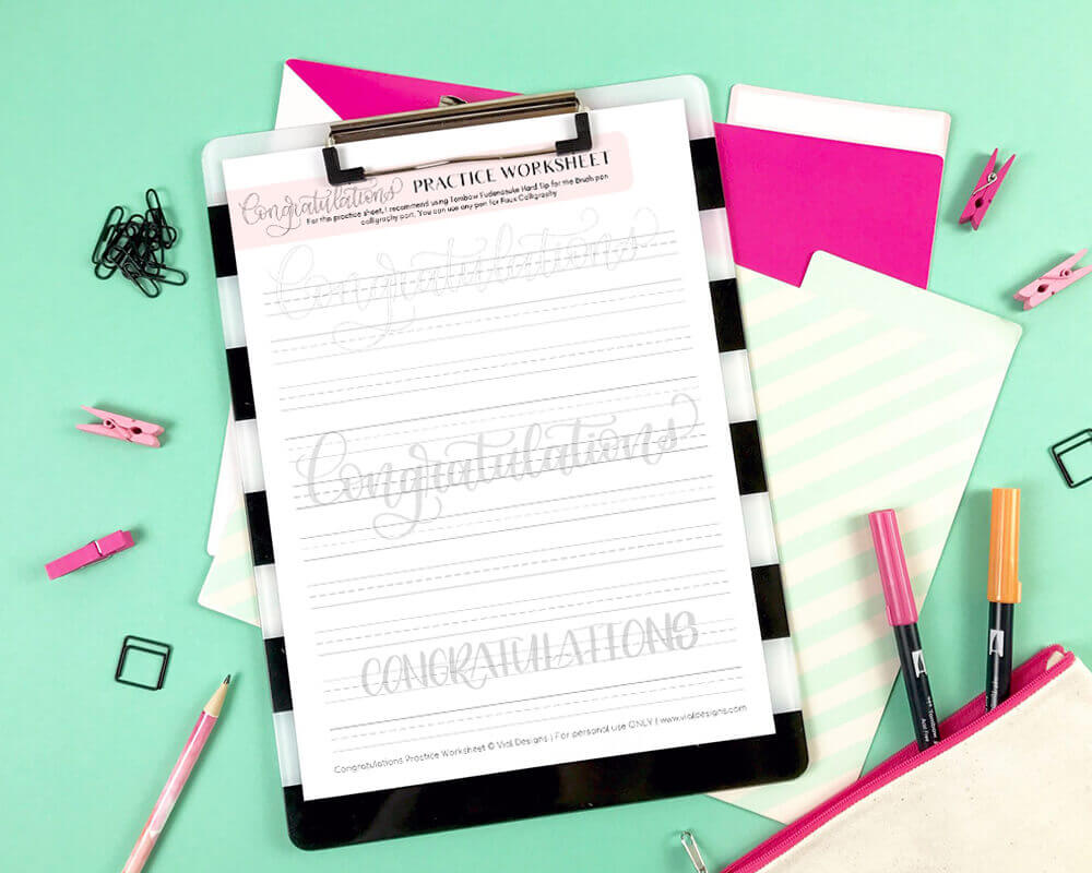 Congratulations Free Calligraphy Worksheet on a Clipboard with Green Background