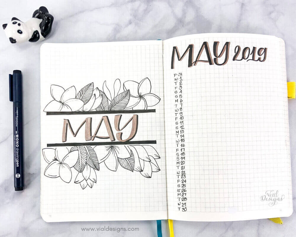 May 2019 Bullet Journal Cover page with floral line drawings and calendar page by Vial Designs