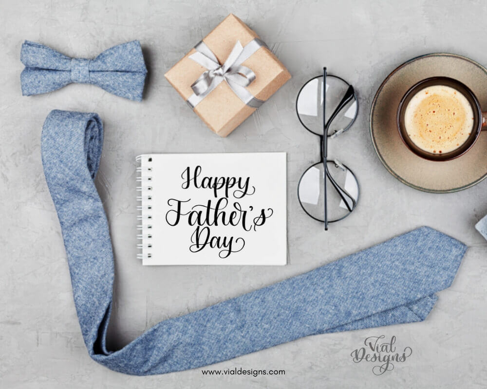 Display of a tie, gift, and glasses, and a Happy Father's Day Calligraphy Note