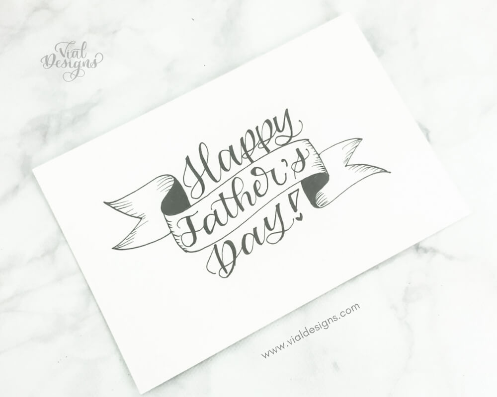 Happy Father's Day lettered on the white cardstock