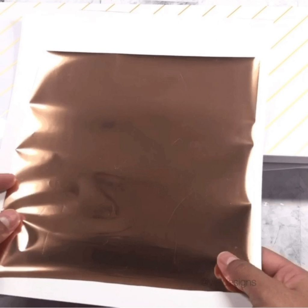 How to Foil Christmas Prints Tutorial Step 2 - Covering the design with the foil transfer sheet