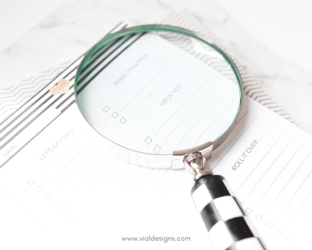 How to find time to practice calligraphy? Magnifying glass with worksheet