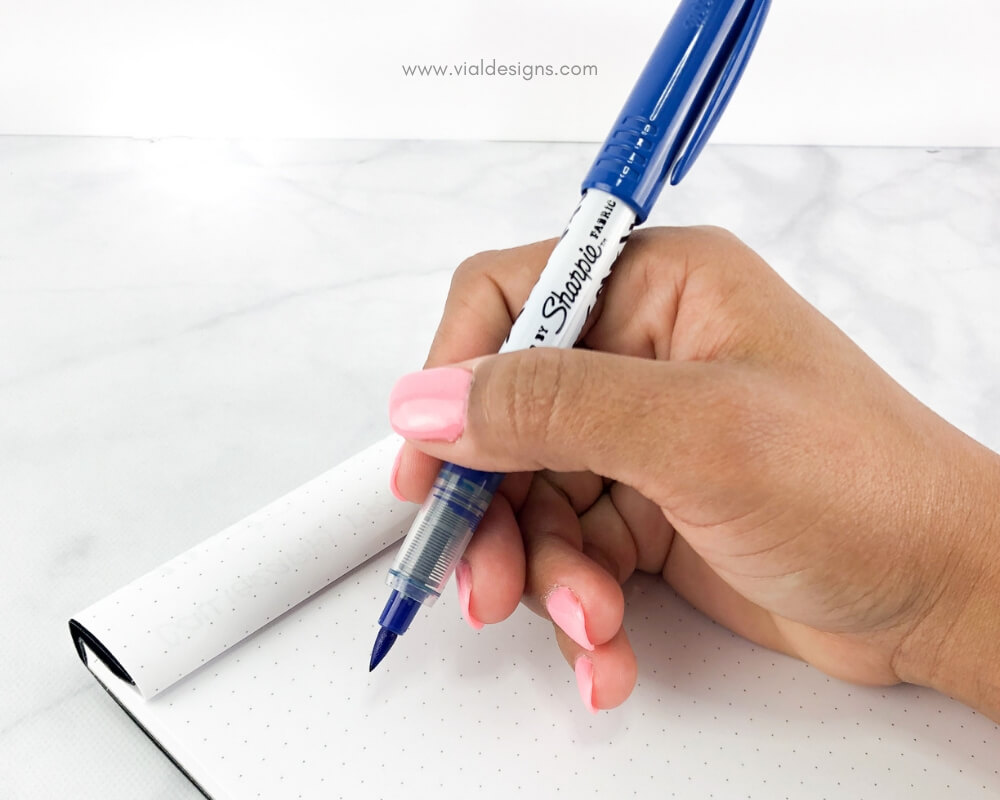How to hold the brush pen_using a blue sharpie stained fabric pen by Vial Designs