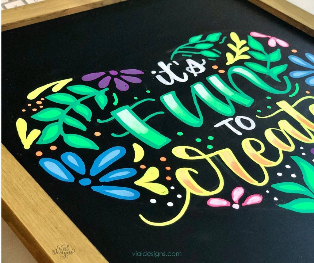 Side angle picture of the chalkboard lettering sign it's fun to create