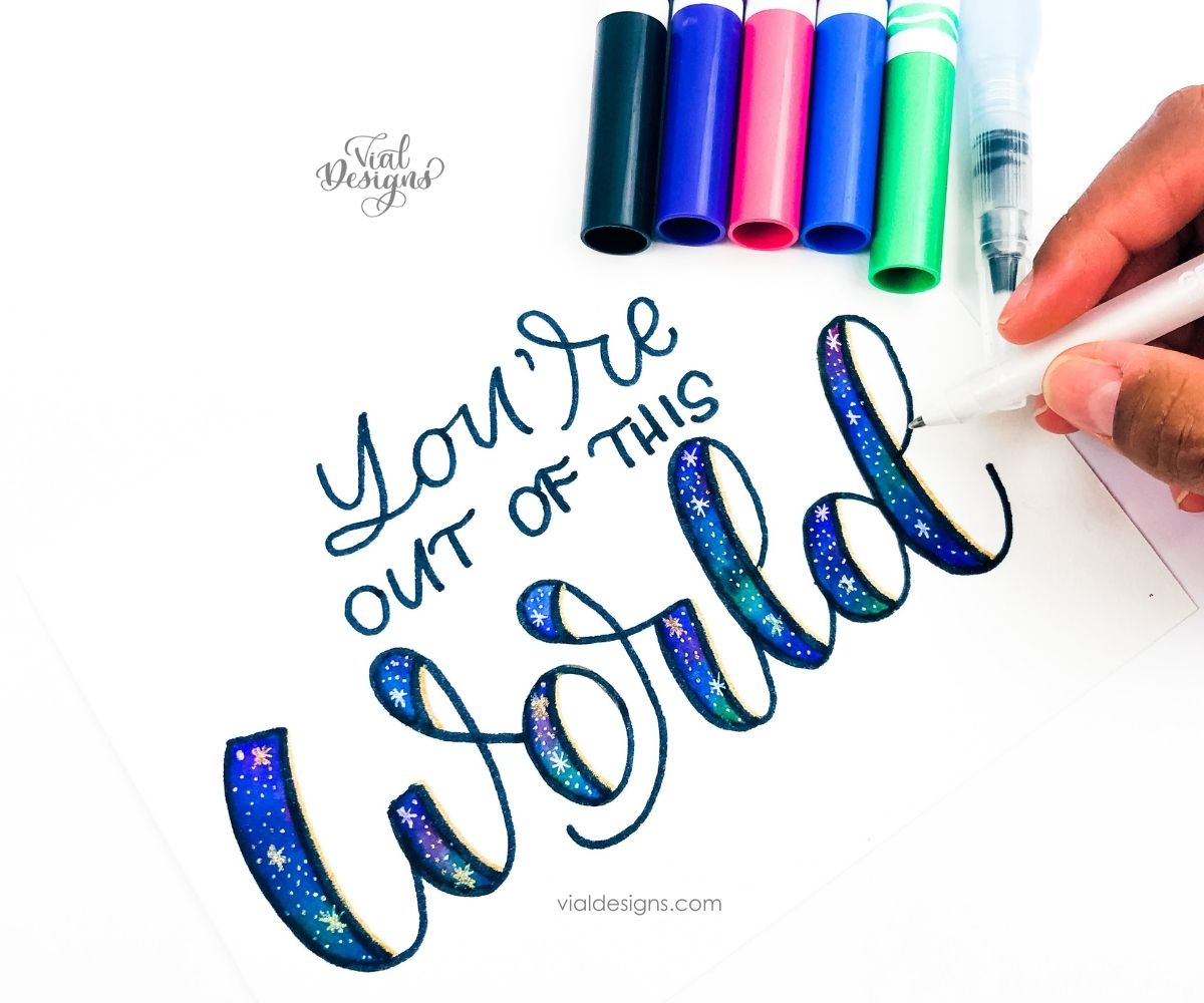 You're out of this world galaxy lettering with crayola markers