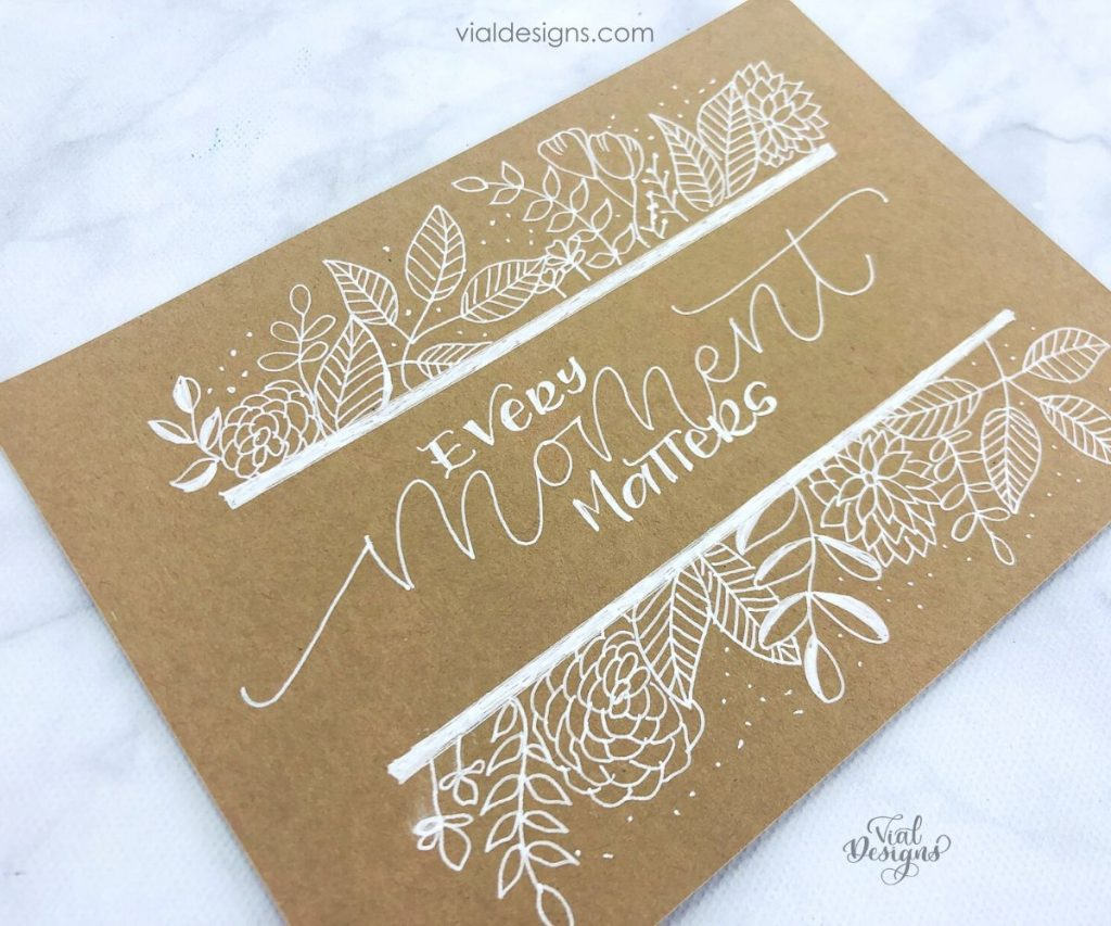 angle view of the every moment matters floral drawing lettering